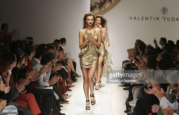 Models walk the runway as part of Valentin Yudashkin's Spring/Summer 2006 women's fashion show during Milan Fashion Week September 28, 2005 in Milan,...