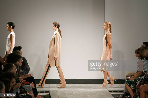 Models walk the runway as Vogue editor Anna Wintour watches at the Reed Krakoff spring 2013 fashion show during MercedesBenz Fashion Week at Skylight...