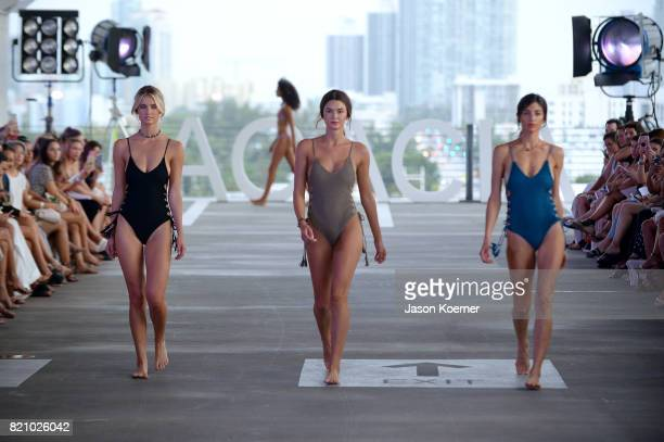 Models walk the runway at ACACIA fashion show during FUNKSHION Swim Fashion Week at 1111 Lincoln Road on July 22 2017 in Miami Florida
