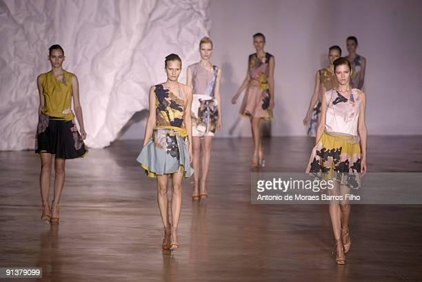 Models walk the runway at Cacharel Pret a Porter during Paris Womenswear Fashion Week Spring/Summer 2010 at Palais de Tokyo on October 3 2009 in...