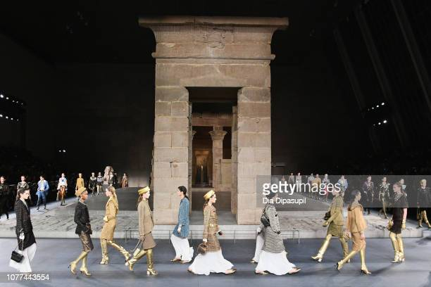 Models walk the runway at Chanel Metiers D'Art 2018/19 Show at The Metropolitan Museum of Art on December 04 2018 in New York City