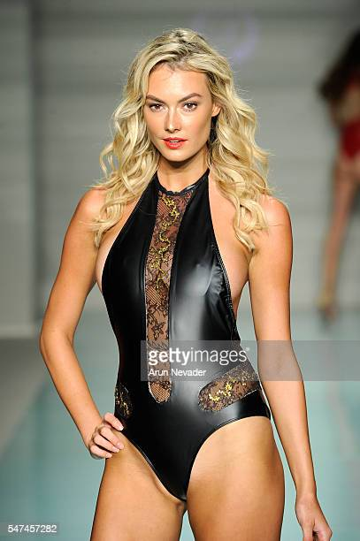 Models walk the runway at Cirone Swim Runway Show during Art Hearts Fashion Miami Swim Week Presented by AIDS Healthcare Foundation at Collins Park...
