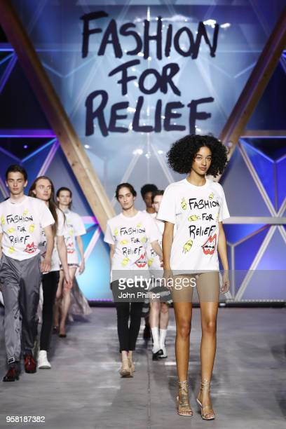 Models walk the Runway at Fashion for Relief Cannes 2018 during the 71st annual Cannes Film Festival at Aeroport Cannes Mandelieu on May 13 2018 in...
