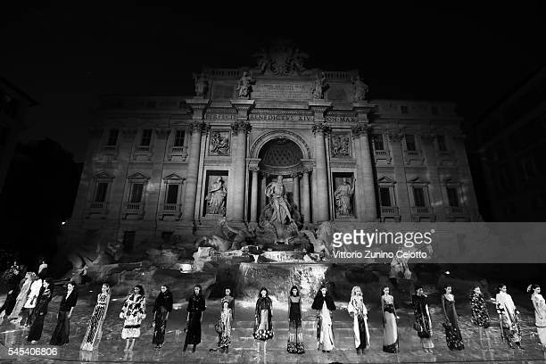 Models walk the runway at Fendi Roma 90 Years Anniversary fashion show at Fontana di Trevi on July 7, 2016 in Rome, Italy.
