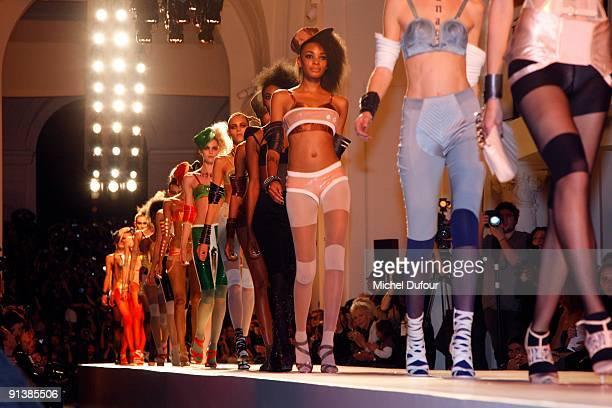 Models walk the runway at JeanPaul Gaultier Pret a Porter during Paris Womenswear Fashion Week Spring/Summer 2010 at 325 Rue Saint Martin on October...
