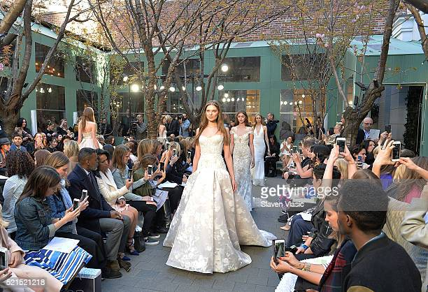 Models walk the runway at Monique Lhuillier Bridal Spring/Summer 2017 Fashion Show at Laduree Soho on April 15 2016 in New York City