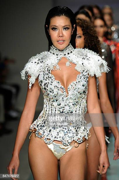 Models walk the runway at Rocky Gathercole Runway Show during Art Hearts Fashion Miami Swim Week Presented by AIDS Healthcare Foundation at Collins...