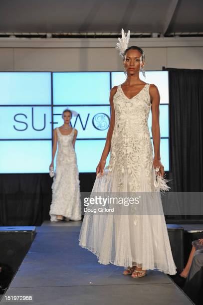 Models walk the runway at the 2012 Sue Wong 'Autumn Sonata' collection Fashion Show during the sixth annual Designer Runway event on September 13...