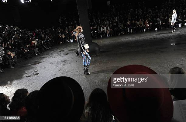 Models walk the runway at the 3.1 Phillip Lim during Fall 2013 Mercedes-Benz Fashion Week on February 11, 2013 in New York City.