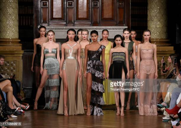 Models walk the runway at the AADNEVIK show during London Fashion Week September 2019 at The Royal Horseguards on September 15 2019 in London England