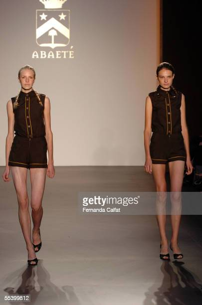 Models walk the runway at the Abaete Spring 2006 fashion show during Olympus Fashion Week at the New York Public Library September 14 2005 in New...