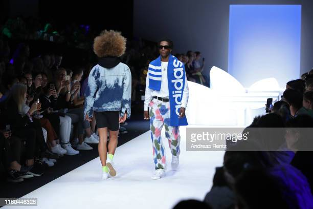 Models walk the runway at the Adidas fashion show during the AYFW - About You Fashion Week at ewerk on July 06, 2019 in Berlin, Germany.