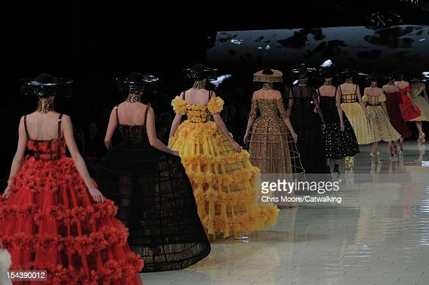 Models walk the runway at the Alexander McQueen Spring Summer 2013 fashion show during Paris Fashion Week on October 2, 2012 in Paris, France.