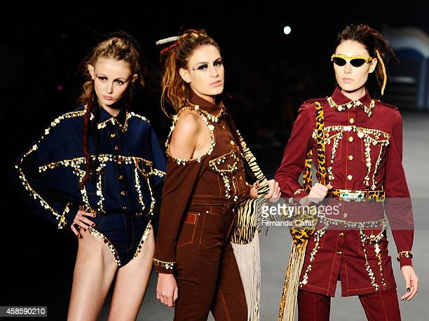 Models walk the runway at the Amapo fashion show during Sao Paulo Fashion Week Winter 2015 at Parque Candido Portinari on November 7 2014 in Sao...