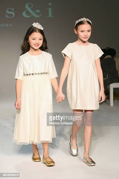 Models walk the runway at the Anais I show during petitePARADE / Kids Fashion Week at Bathhouse Studios on February 28 2015 in New York City