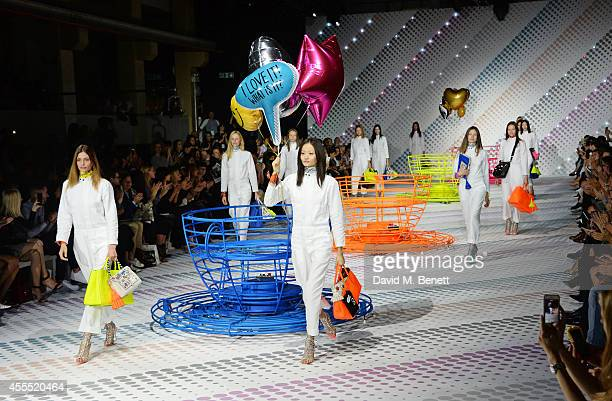 Models walk the runway at the Anya Hindmarch SS15 Presentation during London Fashion Week at Ambika P3 Gallery on September 16 2014 in London England
