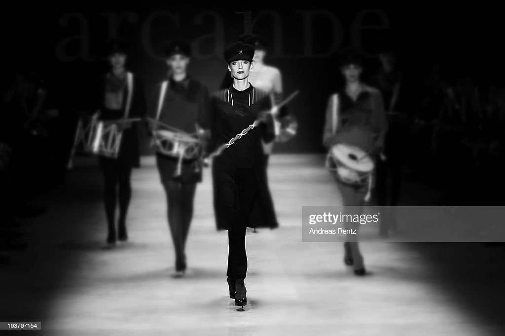 Models walk the runway at the ArGanDe show during Mercedes-Benz Fashion Week Istanbul Fall/Winter 2013/14 at Antrepo 3 on March 15, 2013 in Istanbul, Turkey.