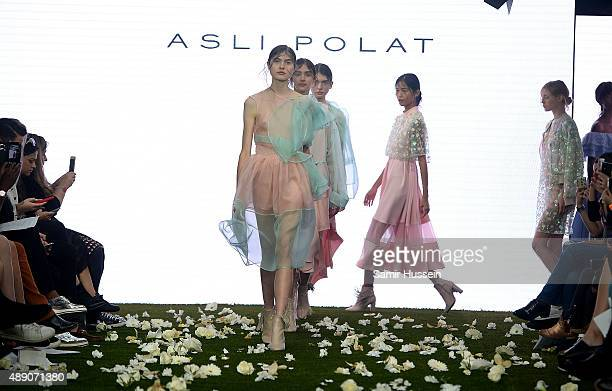Models walk the runway at the Asli Polat show during London Fashion Week Spring/Summer 2016/17 on September 19 2015 in London England