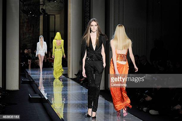 Models walk the runway at the Atelier Versace Spring Summer 2014 fashion show during Paris Haute Couture Fashion Week on January 19 2014 in Paris...