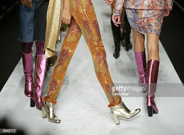 Models walk the runway at the Atil Kutoglu fashion show during Olympus Fashion Week at Bryant Park February 7 2004 in New York City