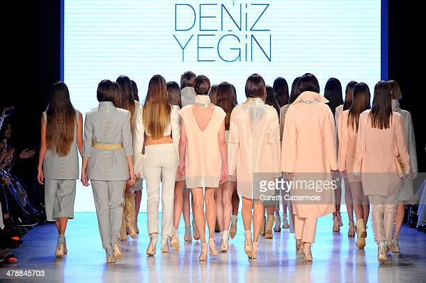 Models walk the runway at the Ayse Deniz Yegin show during MBFWI presented by American Express Fall/Winter 2014 on March 15 2014 in Istanbul Turkey