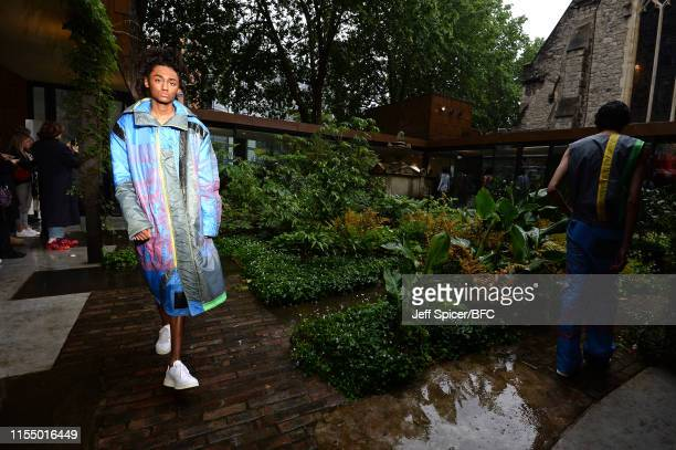 Models walk the runway at the Bethany Williams presentation during London Fashion Week Men's June 2019 at The Garden Museum on June 10 2019 in London...