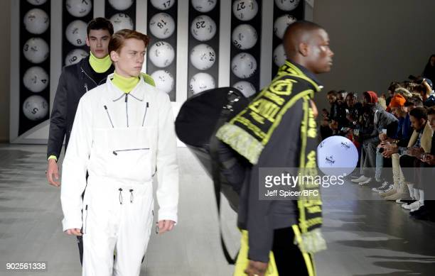 Models walk the runway at the Blood Brother show during London Fashion Week Men's January 2018 at BFC Show Space on January 8 2018 in London England