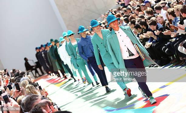 Models walk the runway at the Burberry Prorsum show during the London Collections Men SS15 at Kensington Gardens on June 17 2014 in London England