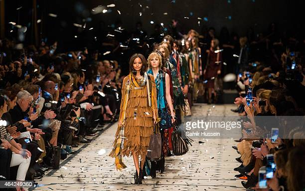 Models walk the runway at the Burberry Prosum show during London Fashion Week Fall/Winter 2015/16 at perk's Field on February 23 2015 in London...