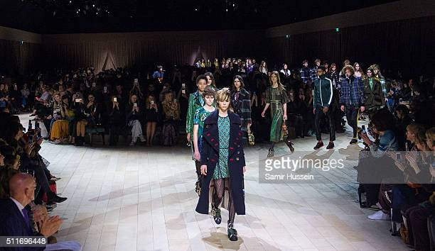 Models walk the runway at the Burberry show during London Fashion Week Autumn/Winter 2016/17 at Kensington Gardens on February 22 2016 in London...