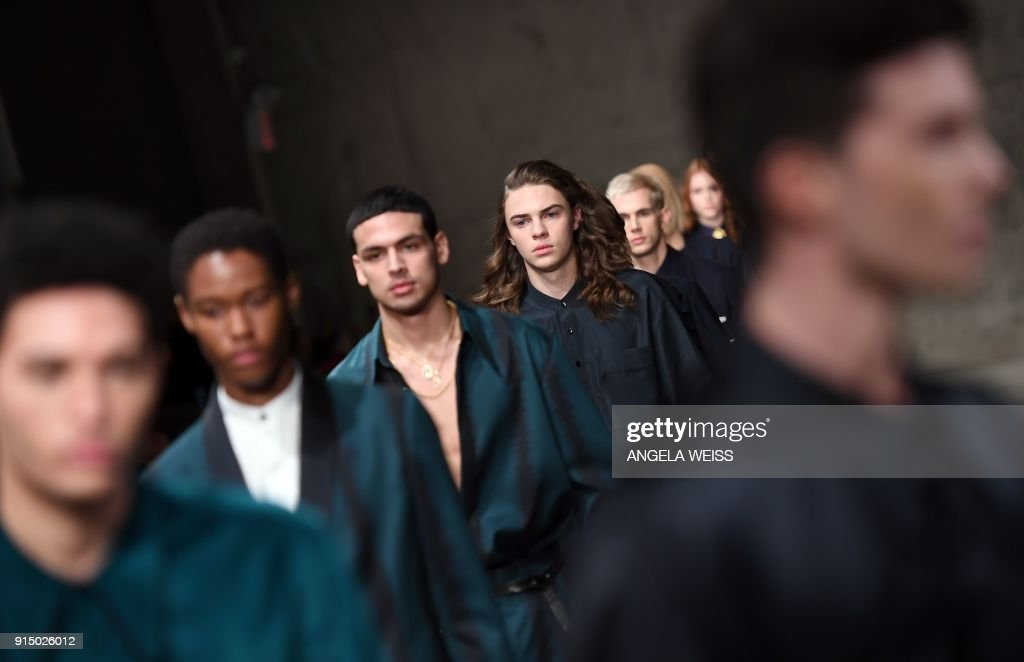 Models walk the runway at the Carlos Campos fashion show during New York Fashion Week Mens' at Skylight Modern on February 6, 2018 in New York City. /