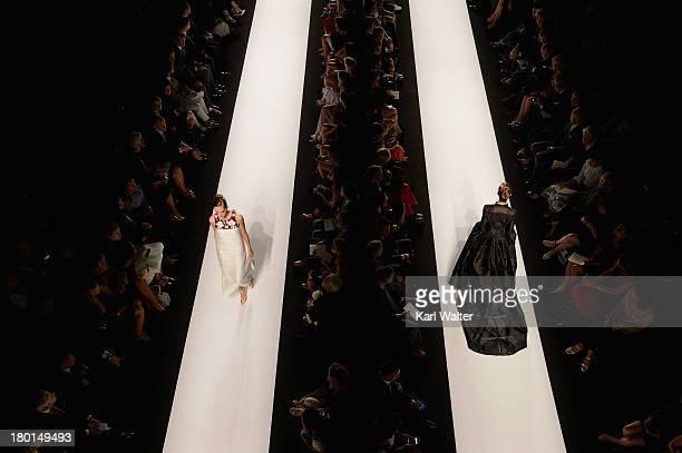 Models walk the runway at the Carolina Herrera fashoin show during Mercedes-Benz Fashion Week Spring 2014 at Lincoln Center for the Performing Arts...
