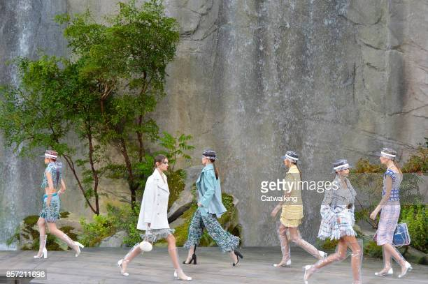 Models walk the runway at the Chanel Spring Summer 2018 fashion show during Paris Fashion Week on October 3 2017 in Paris France