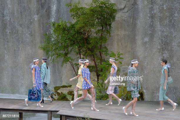 Models walk the runway at the Chanel Spring Summer 2018 fashion show during Paris Fashion Week on October 3, 2017 in Paris, France.