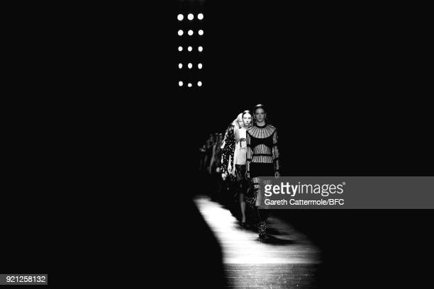 Models walk the runway at the Christopher Kane show during London Fashion Week February 2018 at Tate Britian on February 19, 2018 in London, England.
