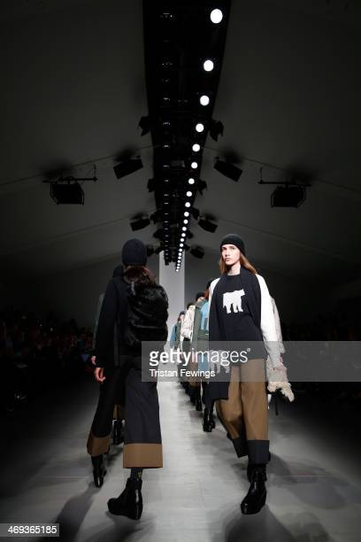 Models walk the runway at the Christopher Raeburn show at London Fashion Week AW14 at Somerset House on February 14 2014 in London England