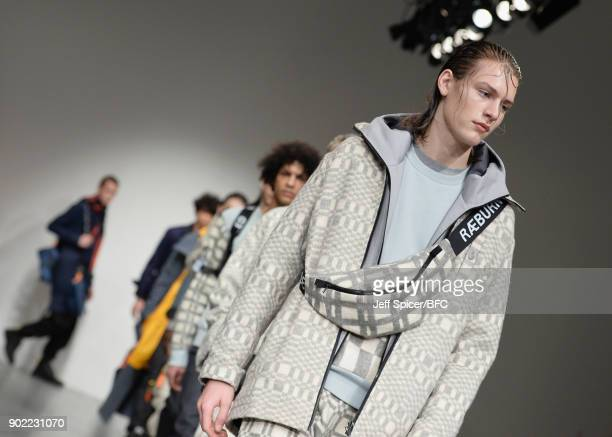 Models walk the runway at the Christopher Raeburn show during London Fashion Week Men's January 2018 at BFC Show Space on January 7 2018 in London...