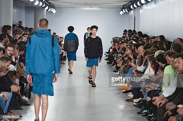 Models walk the runway at the Christopher Raeburn Spring Summer 2017 fashion show during London Menswear Fashion Week on June 12, 2016 in London,...