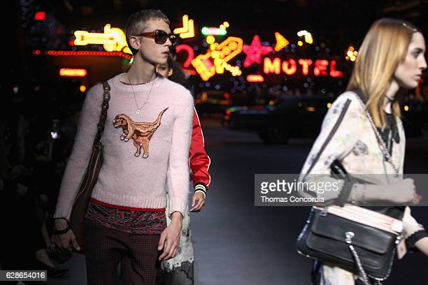 Models walk the runway at the Coach 75th Anniversary Women's PreFall and Men's Fall Show Runway on December 8 2016 in New York City