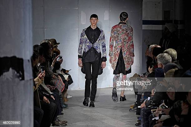 Models walk the runway at the Comme Des Garcons Autumn Winter 2015 fashion show during Paris Menswear Fashion Week on January 23 2015 in Paris France