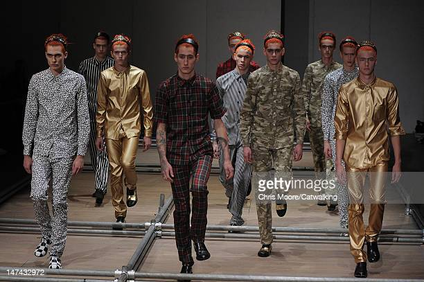 Models walk the runway at the Comme Des Garcons Homme Plus Spring Summer 2013 fashion show during Paris Menswear Fashion Week on June 29 2012 in...