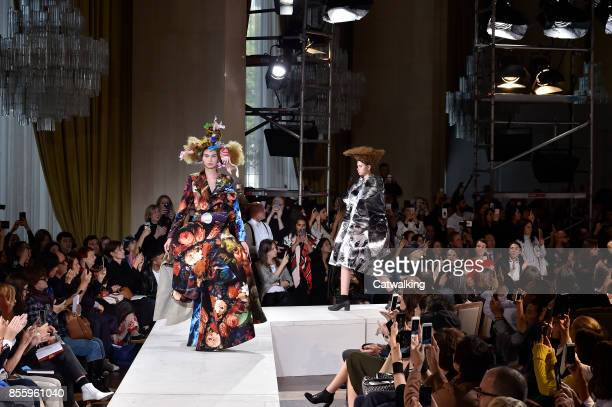 Models walk the runway at the Comme Des Garcons Spring Summer 2018 fashion show during Paris Fashion Week on September 30 2017 in Paris France