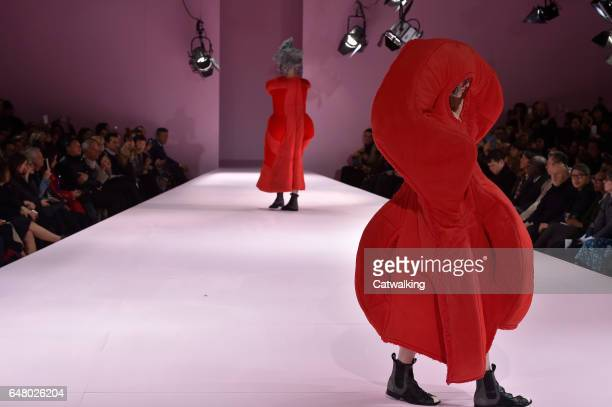 Models walk the runway at the Commes Des Garcons Autumn Winter 2017 fashion show during Paris Fashion Week on March 4, 2017 in Paris, France.
