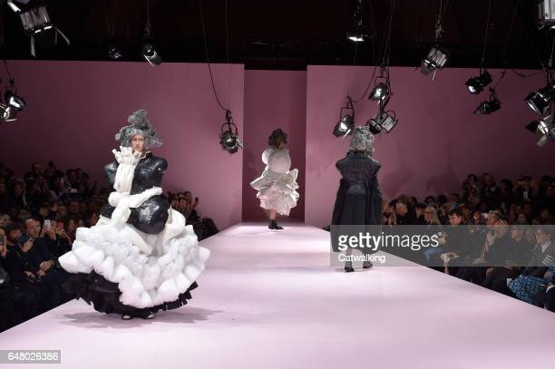 Models walk the runway at the Commes Des Garcons Autumn Winter 2017 fashion show during Paris Fashion Week on March 4 2017 in Paris France