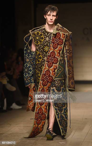 Models walk the runway at the Craig Green show during London Fashion Week Men's January 2017 collections at Topman Show Space on January 6, 2017 in...