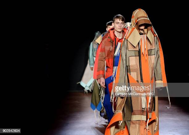 Models walk the runway at the Craig Green show during London Fashion Week Men's January 2018 at The Workshop on January 8 2018 in London England