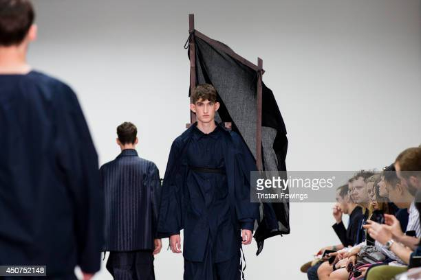 Models walk the runway at the Craig Green show during the London Collections Men SS15 on June 17 2014 in London England
