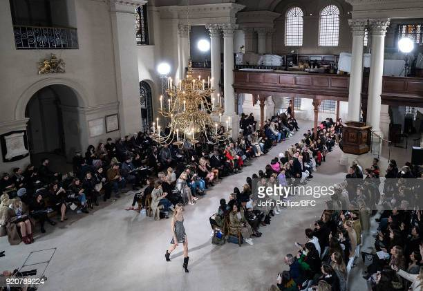 Models walk the runway at the David Koma show during London Fashion Week February 2018 at St George's Church Bloomsbury on February 19 2018 in London...