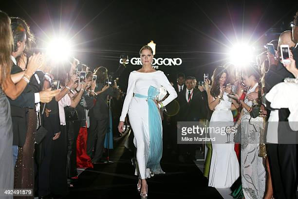Models walk the runway at the De Grisogono dinner party in collaboration with Gyunel during Cannes film festival at Hotel du CapEdenRoc on May 20...