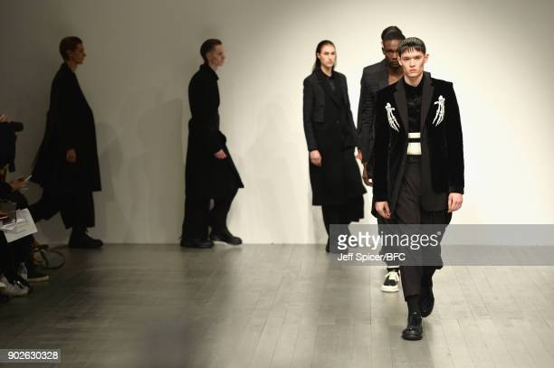 Models walk the runway at the DGNAK show during London Fashion Week Men's January 2018 at BFC Show Space on January 8 2018 in London England